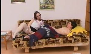 Chubby brunette mom helps a lad to start his day properly