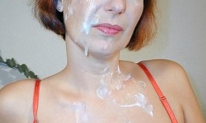 mature redhead getting her face wet with cum