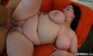 Fatty with huge melons enjoys his cock