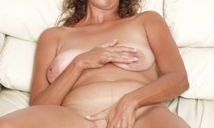 mature brunette mama showing off her pierced nipples