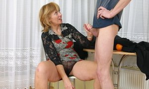 Horny momma lifts her legs for deep penetration.